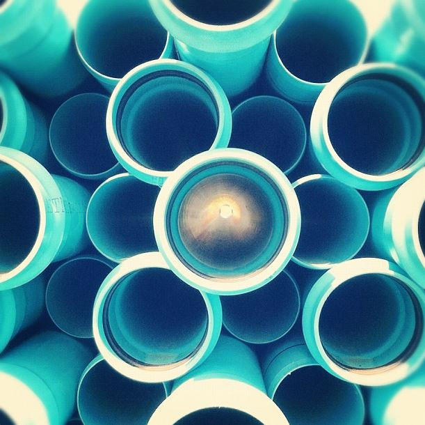 Interesting light can be found in some pretty unlikely places, such as these empty pipes left behind by a construction crew. Photo: Waterveins by Tiffany Mueller